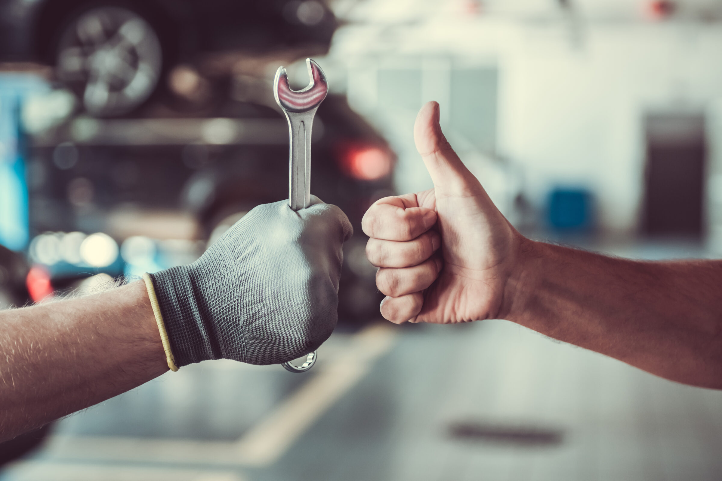 Cropped,Image,Of,Mechanics,Working,In,Auto,Service.,One,Is